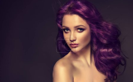 Beautiful girl with violet, curly hair on dark background