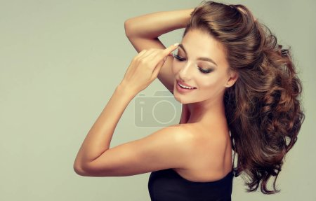 Photo for Young, brown haired woman with  wavy hair .Beautiful model with long,  hairstyle . - Royalty Free Image