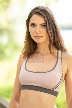 Portrait of a beautiful young sporty girl...