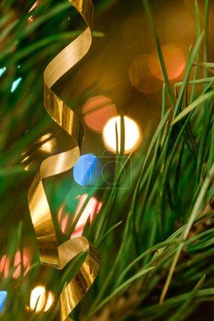 Foto de Serpentine throws hanging on festive Christmas fir tree - Imagen libre de derechos