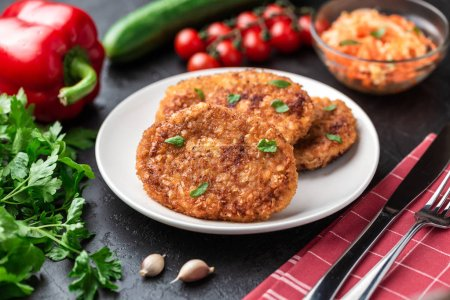 Photo for Plate of fresh fried cutlets on rustic table - Royalty Free Image
