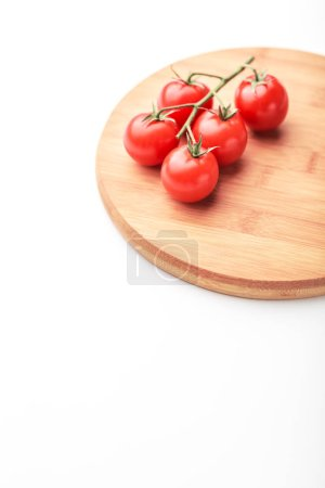 Photo for Ripe cherry tomatoes on wooden board isolated on white - Royalty Free Image