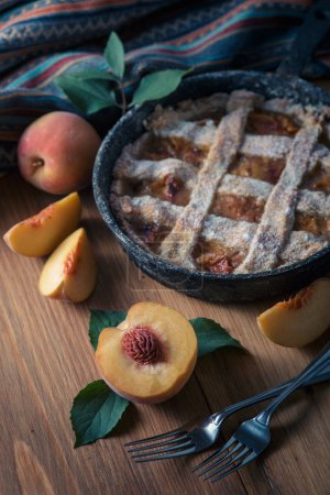 Photo for Fresh homemade peach pie on table with fresh fruit - Royalty Free Image
