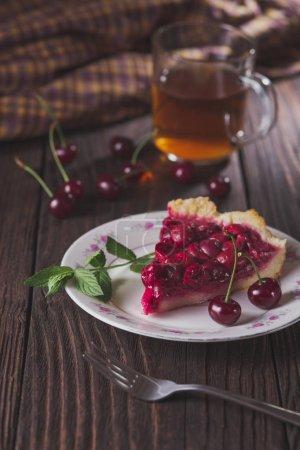 Photo for Slice of fresh cherry pie on plate on rustic table - Royalty Free Image