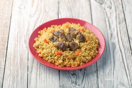 Photo for Plate of homemade pilaf dish with meat and vegetables - Royalty Free Image