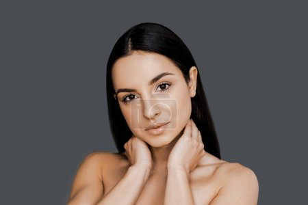 Photo for Portrait of beautiful brunet woman over the grey studio background, healthy skin and beauty procedure concept. Perfect skin and hair after cosmetology procedures in spa salon. Sensual, feminine. - Royalty Free Image