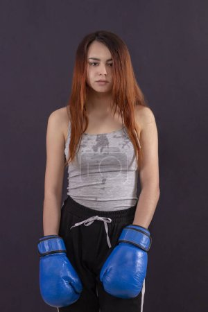 Boxer girl boxing gloves standing tired and sweat ...