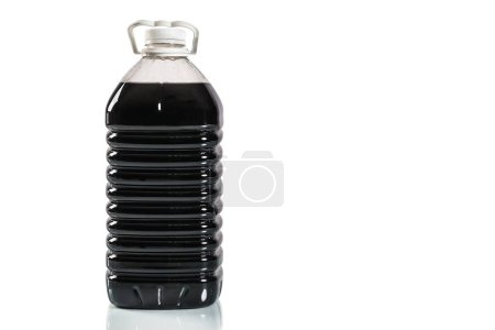 Photo for Transparent plastic canister with a black liquid. - Royalty Free Image