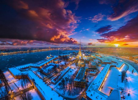 Photo for Center of Petersburg. Peter-Pavel's Fortress. Russia. Snow-covered city from a height. Winter view of St. Petersburg on the Neva River. Russia. Winter Petersburg. - Royalty Free Image