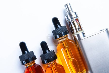 Photo for VAPE and liquids for it. The concept of vaping. E-cigarette liquids. Shop for vapers. Smoking electronic cigarettes. Sale of accessories for vaping. - Royalty Free Image