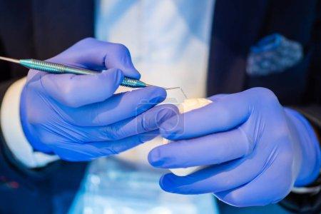 Dental modeling. Dental technician honing plaster ...