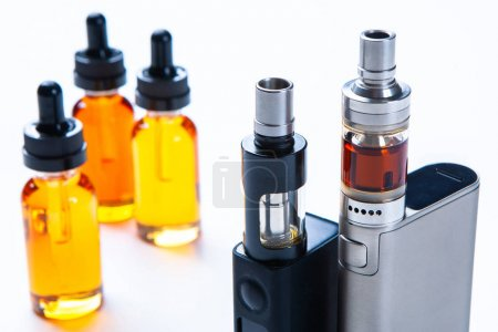 Photo for The concept of vaping. Electronic cigarettes and accessories. Smoking devices. Flavored liquids for Smoking. Gadgets for electronic cigarettes. Shop for vapers. E-cigarette - Royalty Free Image