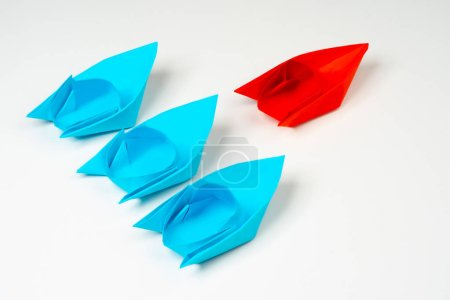Concept leadership qualities. Origami from paper. To lead. Leader. Lead the team forward. Leader. Good leader. The concept for the recruiter - manager. Business leadership concept and mission vision