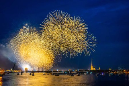 Photo for Russia. St. Petersburg on a festive evening. Fireworks over the Neva. Fireworks in the night sky. View of St. Petersburg holiday. Salute in honor of the holiday. Peter and Paul Fortress - Royalty Free Image
