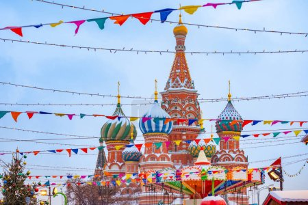 Photo for Moscow. Russia. New year. Christmas. St. Basil's Cathedral. Flags and garlands over the red square. Festive Moscow. The capital is decorated for the New year. Christmas trip to Russia. - Royalty Free Image