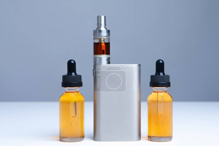 Photo for VAPE and vials of liquid on the table. Smoking electronic cigarettes. The concept of vaping. Accessories for vaper. E-cigarette. Smoking liquid. Shop for vapers. - Royalty Free Image