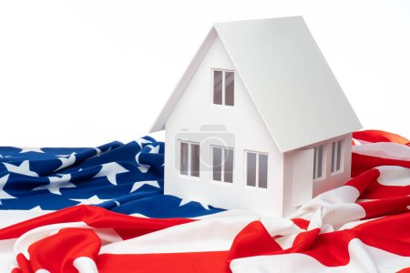 Photo for Layout of the house on the us flag. Moving to America. The acquisition of real estate in the United States of America. Immigration. Accommodation in the USA. - Royalty Free Image