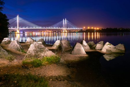 Panorama of the evening city. Bridges Of St. Petersburg. Rivers Of St. Petersburg. Night view of St. Petersburg from the Bank of the Neva. Obukhovskiy bridge. Cable-stayed bridge is beautifully lit.