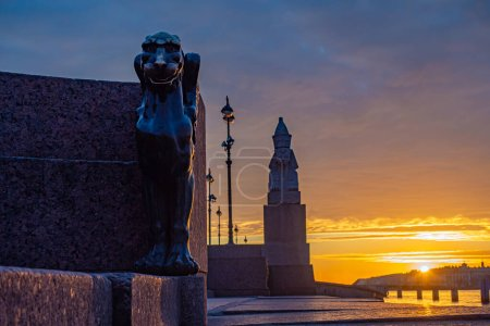 Photo for Evening. Petersburg at sunset. Vasilievsky island. The sun sets on the Neva. Rivers Of St. Petersburg. University embankment. Sculptures on the Neva embankment. The Sphinx at sunset. Travel to Russia. - Royalty Free Image