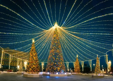 Photo for New year. Decorated Christmas trees on the street. Decoration of luminous garlands. Festive illumination. Christmas card. Unusual design of the square for Christmas. Sense of celebration. - Royalty Free Image