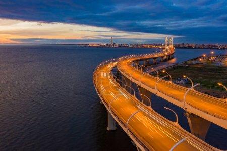 Saint Petersburg. Russia. Obukhov bridge. City Highway at night.