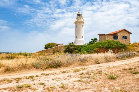 Photo for Republic of Cyprus. Pathos. Lighthouse on the coast. Archaeological park. Paphos archaelogical site. Lighthouse on the shores of the Mediterranean Sea. Walks in Cyprus. House Near Lighthouse - Royalty Free Image