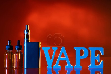 Photo for Vape logo.Vape smoking instead of nicotine. The letters vape on the table.Concept Refusal of nicotine addiction. Liquids for vaper. E-Sigs. Kit for the vaper.Shop for the vaper.Refusal of cigarettes - Royalty Free Image