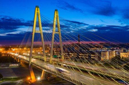 Saint-Petersburg. Cable-stayed bridge in the dark. Vansu bridge. Obukhovskiy bridge. Russia. Evening view of St. Petersburg. A trip by car through the Neva.