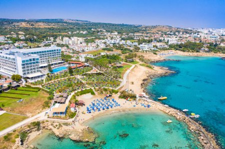 Photo for Republic of Cyprus. Mediterranean coast. The Port Of Paralimni. Pernera. Kalamies beach. Tourist area on the coast. A rocky spit divides the Bay into two parts. Seaside resort. - Royalty Free Image