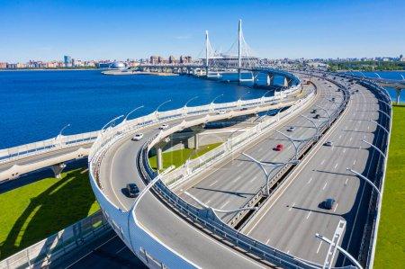 Saint Petersburg. Russia. Traffic on the highway. View of the modern Expressway from Vasilievsky island. Neva. St. Petersburg bridges. The Petersburg road. Vansu bridge. Obukhov bridge.