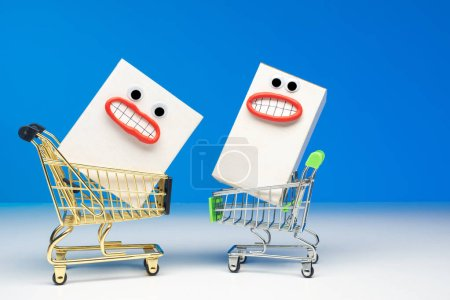Photo for Box. Concept - happiness from the purchase. Shopaholics. The joy of shopping at the supermarket. White packing box. Supermarket carts. The joy of shopping at the store. Supermarket. Shopping. - Royalty Free Image