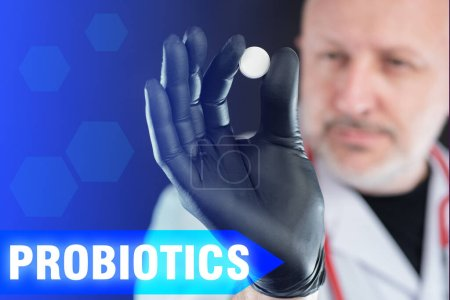 Photo for Probiotics. Doctor holds pill in his hands. Probiotics in pills. Dietary supplement in hand of physician. Concept - doctor recommends probiotics. Doctor recommends biological supplements for immunity - Royalty Free Image