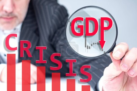 Photo for Forecast fall GDP. Logo of falling GDP inside magnifying glass. Economist with magnifying glass in his hands. Charts show crisis in economy. Rating agency predicts decline in GDP. Production shutdown - Royalty Free Image