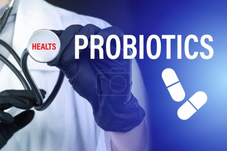 Photo for Health promotion with probiotics. Inscription probiotics next to doctor. Concept - doctor recommends taking probiotics. Doctor holds a stethoscope in his hands. Medic recommends dietary supplements - Royalty Free Image