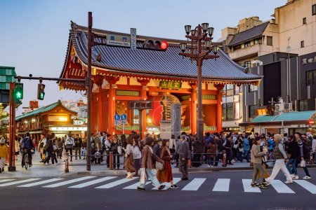 Photo for Japan. Asakusa Temple in evening Tokyo. People at the gates on Asakusa street. Sensoji Temple in the Japanese capital. People on the background of a large Japanese gate. Tourists in Tokyo. 11.09.2019 - Royalty Free Image