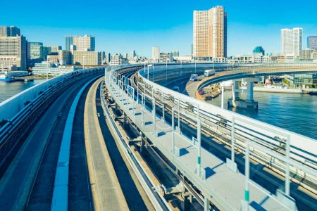 Photo for Japan. Bridge leading to the island of Odaiba. Rainbow bridge close-up. Railway between the islands of Japan. Bridge with the railway against the background of skyscrapers. View of Tokyo - Royalty Free Image