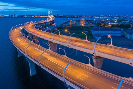 Saint Petersburg in the evening. Russia. Rivers Of St. Petersburg. Bridges Of St. Petersburg. Obukhov bridge over the Neva river. The road goes over a cable-stayed bridge. Speedway over the water.