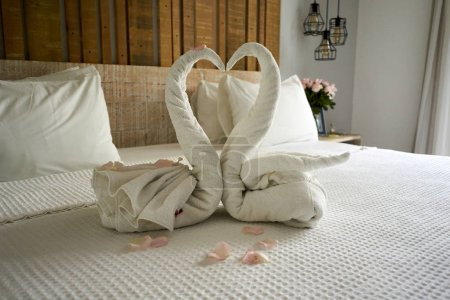 Photo for White towel and heart on bed in a bedroom - Royalty Free Image
