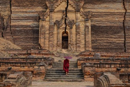 Photo for A young monk coming to ancient Buddhist temple in Bagan, Myanmar. - Royalty Free Image