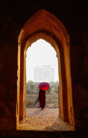 Photo for A young monk standing at ancient Buddhist temple in Bagan, Myanmar. - Royalty Free Image