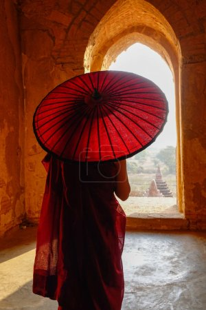 Photo for A young monk standing at Buddhist pagoda in Bagan, Myanmar. - Royalty Free Image