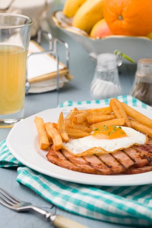 Photo for English breakfast with grilled ham, fried egg and french fries. - Royalty Free Image
