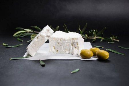 Foto de Feta Greek cheese with olives on black background - Imagen libre de derechos