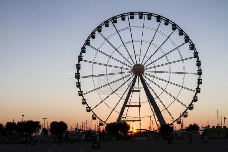 Photo for Sunset view of ferris wheel silhouette - Royalty Free Image