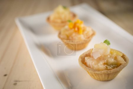 Photo for Delicious bakery products with filling on plate - Royalty Free Image