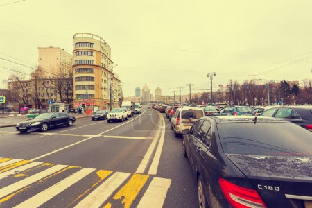 Photo for MOSCOW, RUSSIA - DECEMBER 12 , 2017: People stand in traffic jams in cars on Kutuzov Avenue near the square of Europe near Kiev railway station in Moscow - Royalty Free Image