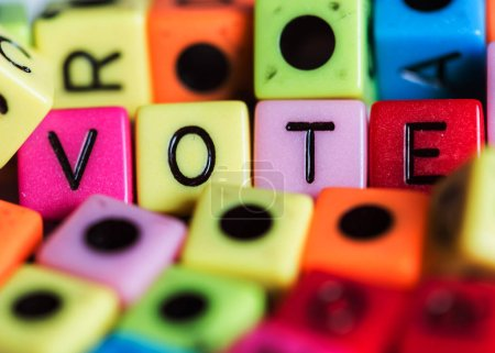 """The word """"VOTE"""" of colored cubes."""