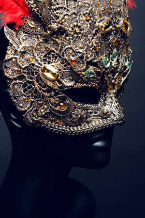iron mask with precious stones and feathers