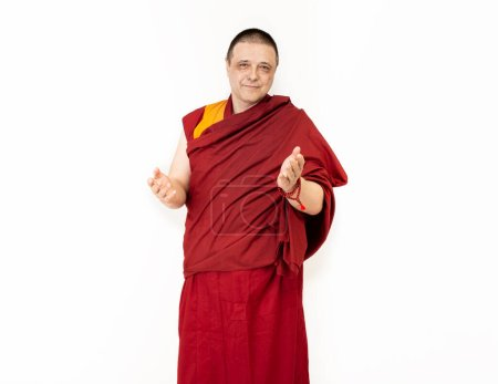 Photo for Porter of a Tibetan Mongolian monk in ritual red clothing on a white background - Royalty Free Image