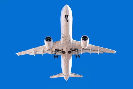 white airplane into a perfect blue sky